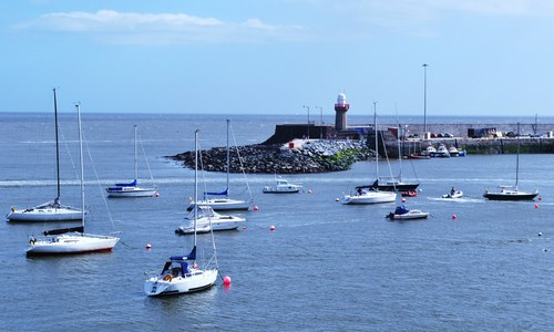 Boats on the water in the region of the pier, Dunmore East, Co. Waterford, Ireland.