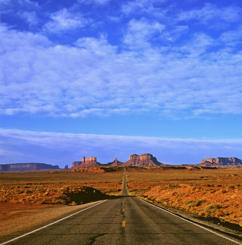Morning view in October of the Iconic Highway 163 which leads from Mexican Hat to Monument Valley on the Arizona and Utah State border, known locally as Gump Hill.