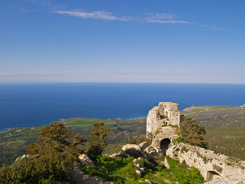 Spring-time view of Kantara, one of the old crusader castle overlooking the northern coastal plain of Northern Cyprus to the Mediterranean Sea beyond.