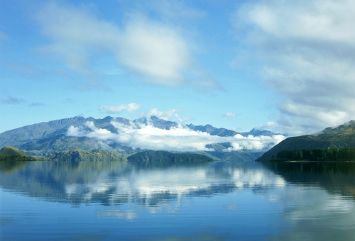 Morning view across the still waters of Lake Wanaka towards the Mt Aspiring National Park in New Zealand's South Island.