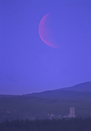 Oh what a night!! A total lunar eclipse and clear skies, I couldn't have wished for more.  From Donegal, Ireland, Moon rise occurred just after totality but I was still able to capture everything that was visible from my location.  I searched google maps and street view for the past few weeks trying to find the best location in the county to view the eclipse.  The pier in Mountcharles, outside Donegal Town provided a picturesque setting and a clear south eastern horizon, making it my location of choice. The weather forecast was predicating a relatively good chance of clear skies.  So I packed the car up and headed off brimming with excitement.  Upon arrival, I was thrilled with my choice of location but the skies were looking threatening, clouds everywhere….. except the south east and that's the way it stayed all night.  The weather was making up for the bitter disappointment of missing the December eclipse because of cloud.  A few curious passers-by rolled up to have a look.  The excitement was building and then around 22:10..Eureka!! There she was.  The dim, red, eclipsed Moon just hanging over the horizon.  A magical and humbling hour followed as the Moon climbed and grew back into its original form.  An amazing night of astronomy.  Easily the most memorable experience I have had during my short time in astronomy, along with March's aurora display.  Image Details: Location: Mountcharles, outside Donegal Town, Ireland Date: 15Jun2011 Time: 22:00-23:30