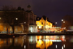 Slow Shutter Shot of the Old Portobello College Reflecting over a semi frozen canal.