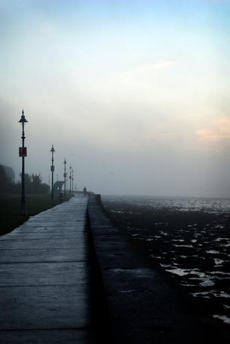 A walker fades into the mist, Clontarf Promenade