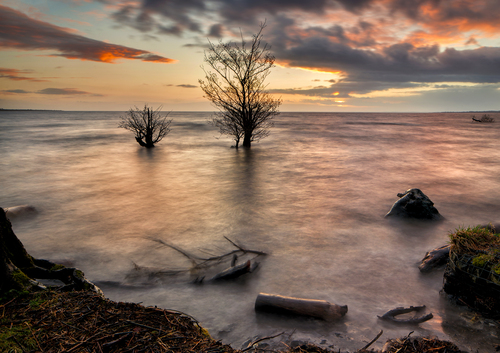 "Lough Neagh, sometimes Loch Neagh,is a freshwater lake in Northern Ireland. It is the biggest lake in Northern Ireland, supplying 40% of its water; the biggest in Ireland, and the biggest in the British Isles.Its name comes from Irish: Loch nEathach, meaning ""Lake of Eathach"""
