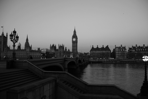 Black and white photograph taken from the south bank of the River Thames showing Westminster Bridge and The Houses of Parliament/Big Ben.