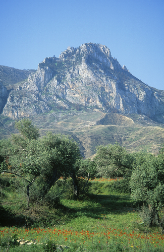 View of the old crusader castle of St Hilarion overlooking Kyrenia as seen from Zeytinlik in Northern Cyprus.