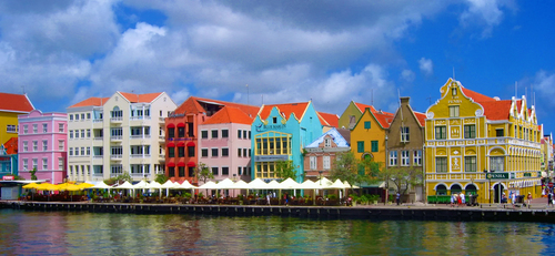 The colourful and historic waterfront of Willemstad on the Carribbean island of Curacao. Since 1997 the UNESCO recognizes Willemstad as a World Heritage Site. Curacao is a beautiful little island which, with Aruba,  is part of the Dutch Antilles in the West Indies.