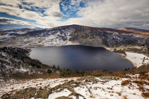 Lough Tay is a small but scenic lake set in the Wicklow Mountains in County Wicklow, Ireland. It lies between the mountains of Djouce and Luggala.