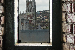 view of north cathedral taken through old glass window