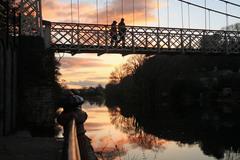 "a couple cross the ""shakey bridge""on a fine spring evening"