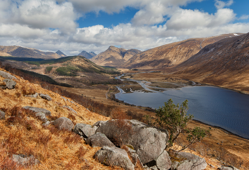 Glen Etive is a glen in the Highlands of Scotland. The River Etive rises on the peaks surrounding Rannoch Moor, with several tributary streams coming together  at the head of Glen Coe.
