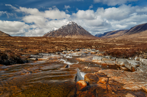 "Buachaille Etive Mòr (Scottish Gaelic: Buachaille Eite Mòr, meaning ""the great herdsman of Etive""), generally known to climbers simply as The Buachaille or The Beuckle, is a mountain at the head of Glen Etive in the Highlands of Scotland. Its almost perfect pyramidal form, as seen from the A82 road when travelling towards Glen Coe, makes it one of the most recognisable mountains in Scotland, and one of the most depicted on postcards and calendars."