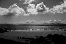 Black and white photograph taken from Salthill Promenade looking out over Galway Bay.