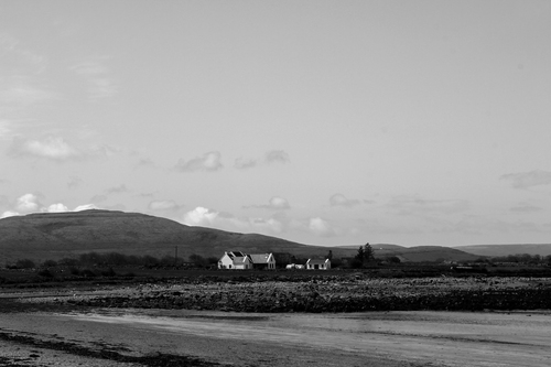 Black and white photograph looking out towards The Burren in County Clare.