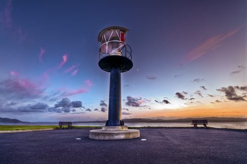 A HDR image of Buncrana lighthouse just after the sunset to the right of the lighthouse you can see the moon..