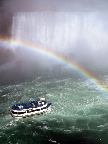 A 'Maid Of The Mist', there have been 7 over the years, heads into the cauldron at the bottom the Horseshoe Falls on the Canadian side of the 'Niagara Falls'.