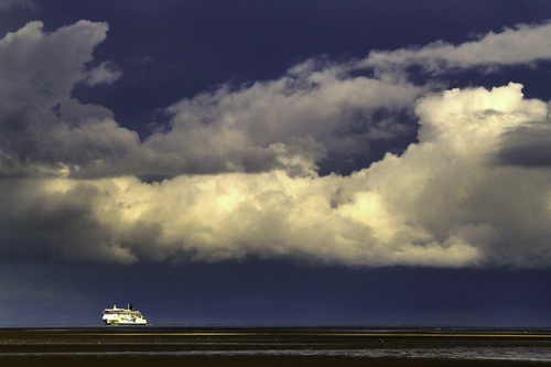 As the storm rumbles towards Wales the travellers return