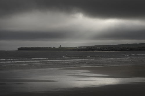 A moody image of Lahinch beach as the Atlantic advances towards the land