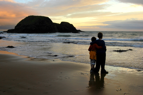 Young brothers watching the sunset on Annestown Beach, Co. Waterford