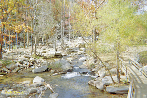 Over the creek, which is nestled up in the mountains of Chimney Rock