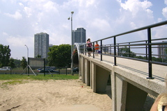 Photo taken in summer of 2009 of the Walkway Bridge going from city of Chicago onto the beach shores of Lake Michigan