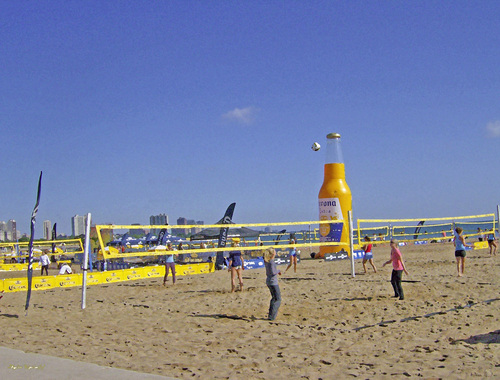 People gather to play volleyball and have fun on the beach