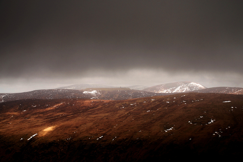 Tóin le Gaoith and Turlough hill on a dark winter's afternoon.