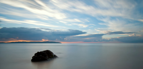 A long exposure at sunset on Downhill Beach with the coastline of Donegal opposite.