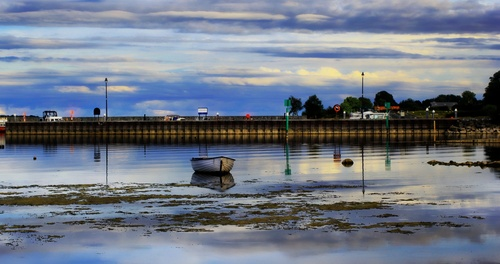 """the pier at Portrun (Irish: Port Reanna, meaning """"Bank of the Point"""") is a lakeside hamlet, located on the bank of Lough Ree on the River Shannon in County Roscommon."""