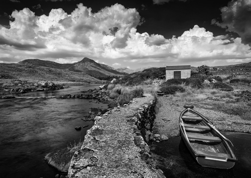 Little boat resting on Ballinahinch River in Connemara.