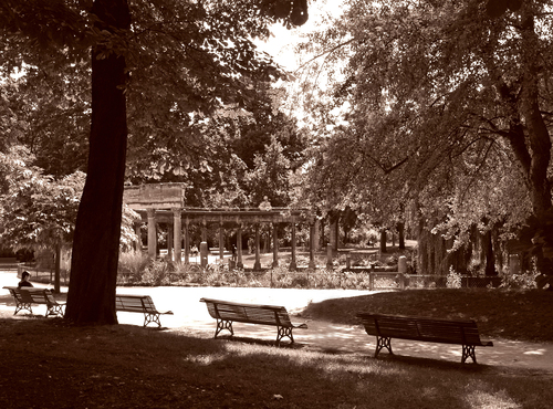 Backlit shot in Sepia of the Colonnade in the Parc Monceau in central Paris, France.