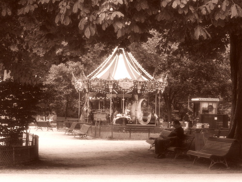 Soft focus shot in sepia of the carrousel Jules Verne in the Parc Monceau in Paris for a more nostalgic feel.