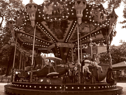Shot in sepia for a nostagic feel of this Carrousel in the parc Monceau in Paris featuring panels and ornate decorative details illustrating Jules verne's stories of adventure and discovery  the late 19th century.
