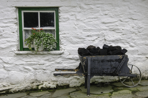 Wheelbarrow and peat