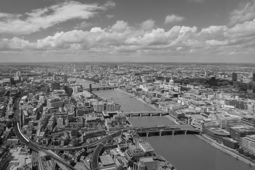 Monochrome cityscape image of the City of London taken from The Shard. London landmarks easily identifiable in the photograph include: St. Pauls Cathedral, BT Tower, London Eye, Millennium Bridge and Tate Modern