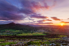 sunset over the sugar loaf and dublin mautains