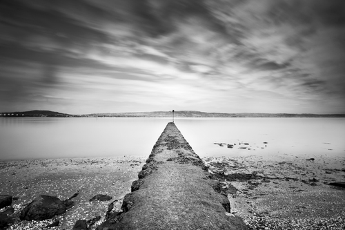 An old marker post at low tide in Belfast Lough at Holywood, Northern Ireland.