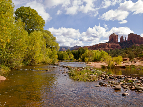 An autumnal view of Red Rock Crossing of Oak Creek beneath the Cathedral Rocks near Sedona in central Arizona.
