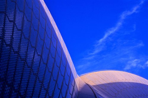 Close-up of the iconic design and patterns of sail-like roof of the Opera House in Sydney harbour, New South Wales.