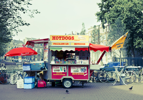 Typical Amsterdam hot dogs street cars on a bridge in the Center.