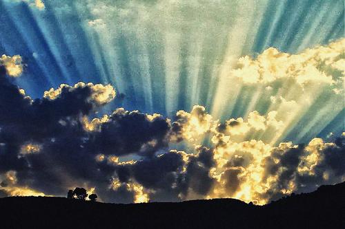 Sunshine drawing lines like a fan around sunset