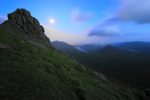 Taken during a full moon on the summit of Slieve Bearnagh in the Mourne Mountains. Visible is the Silent Valley, Doan Mountain and Lough Shannagh.