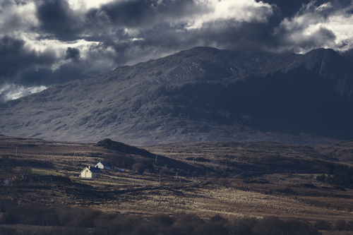 Isolated dwellings in Connemara; despite their modernity they hark back to a bleaker past in rural Ireland.
