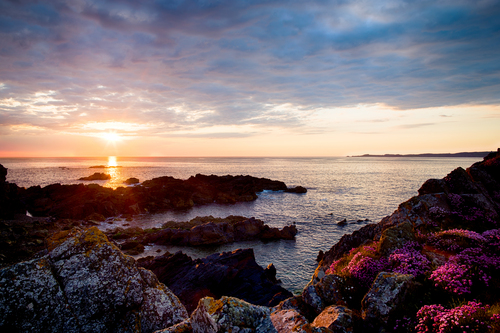 Sunset from Carrickabraghy Castle towards Malin Head on the Isle of Doagh, Clonmany, County Donegal.
