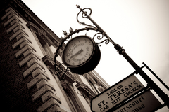 Vintage signs and clock in Dublin.