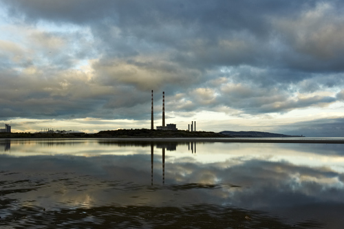 View of Poolebeg Towers with Howth off in the distance from Sandymount Strand just before sunset  in January 2014.