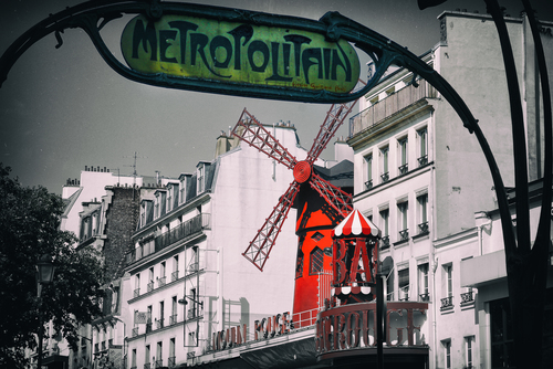 A strong image of the Moulin Rouge, framed by a classical Metro sign, in muted colours.