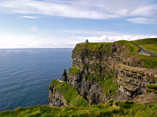 O' Brien's castle on the top of the Cliffs of Moher in County Clare overlooking the Atlantic Ocean on a calm spring afternoon with the Aran Islands in the distance.