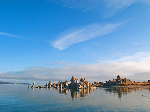 Morning reflections of the strange tufa rock formations on the southern shore of Mono Lake in eastern California.