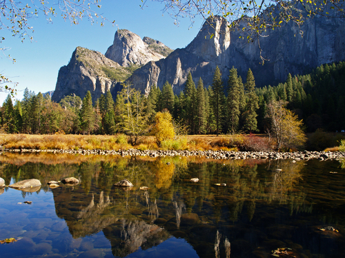 View of Yosemite Valley in early November as the Merced River flows slowly through an autumnal Yosemite National park in eastern California.